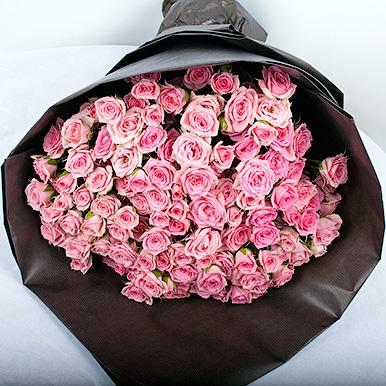 19 кустовых розовых роз в крафте